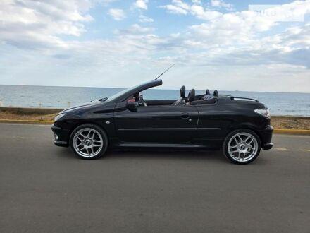 Черный Пежо 206 СС, объемом двигателя 2 л и пробегом 218 тыс. км за 4800 $, фото 1 на Automoto.ua