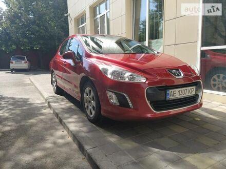 Красный Пежо 308, объемом двигателя 1.6 л и пробегом 65 тыс. км за 9300 $, фото 1 на Automoto.ua
