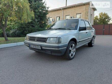 Сірий Пежо 309, об'ємом двигуна 1.9 л та пробігом 192 тис. км за 2000 $, фото 1 на Automoto.ua