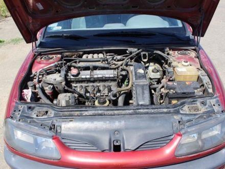 Вишнёвый Рено Лагуна, объемом двигателя 2 л и пробегом 153 тыс. км за 1800 $, фото 1 на Automoto.ua