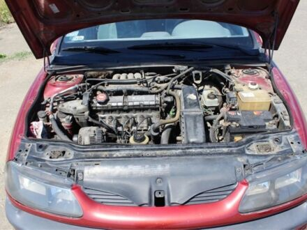 Вишневий Рено Лагуна, об'ємом двигуна 2 л та пробігом 153 тис. км за 1800 $, фото 1 на Automoto.ua