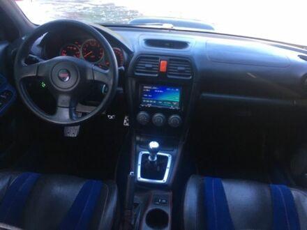 Черный Субару Импреза, объемом двигателя 2.5 л и пробегом 137 тыс. км за 11000 $, фото 1 на Automoto.ua