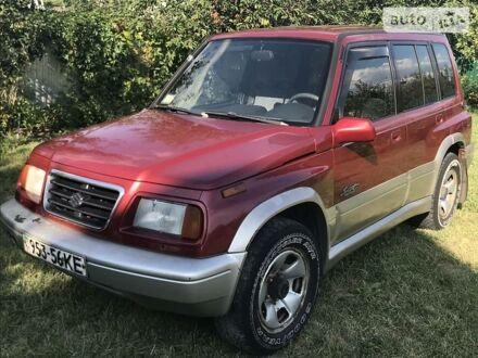 Красный Сузуки Sidekick, объемом двигателя 1.8 л и пробегом 260 тыс. км за 5950 $, фото 1 на Automoto.ua