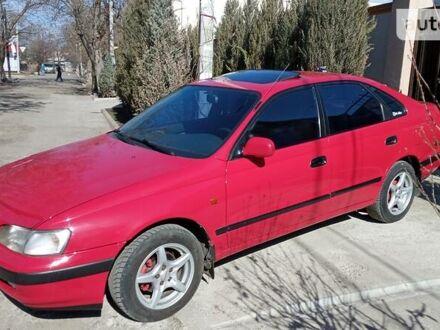 Красный Тойота Карина, объемом двигателя 1.6 л и пробегом 300 тыс. км за 4300 $, фото 1 на Automoto.ua