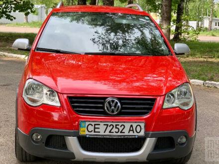 Красный Фольксваген Кросс Поло, объемом двигателя 1.4 л и пробегом 171 тыс. км за 7000 $, фото 1 на Automoto.ua