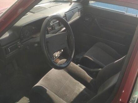 Красный Вольво 240, объемом двигателя 2.1 л и пробегом 325 тыс. км за 650 $, фото 1 на Automoto.ua