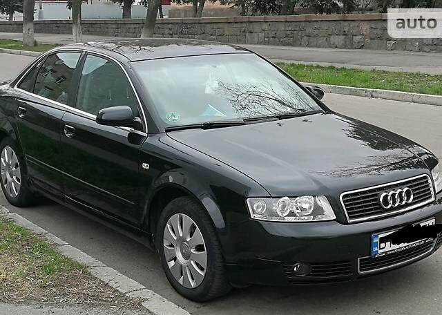 Черный Ауди А4, объемом двигателя 2 л и пробегом 307 тыс. км за 6500 $, фото 1 на Automoto.ua