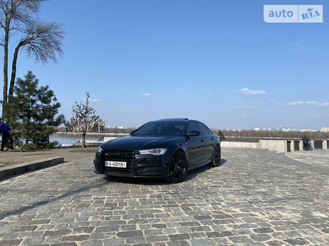 Черный Ауди А6, объемом двигателя 2 л и пробегом 53 тыс. км за 27500 $, фото 1 на Automoto.ua