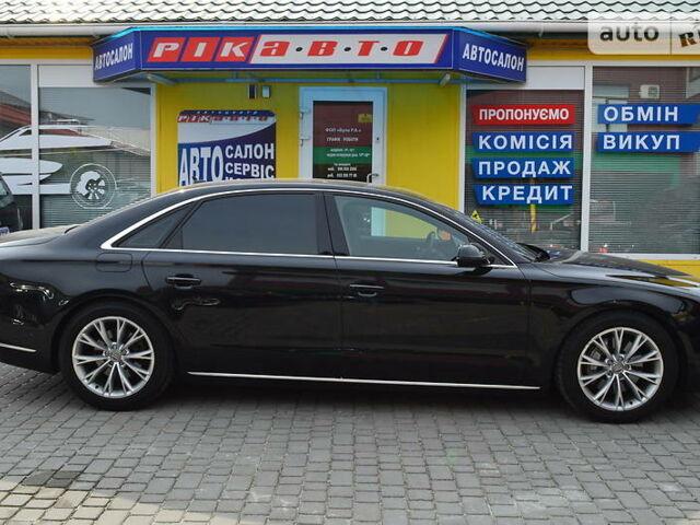 Черный Ауди А8, объемом двигателя 3 л и пробегом 173 тыс. км за 28900 $, фото 1 на Automoto.ua