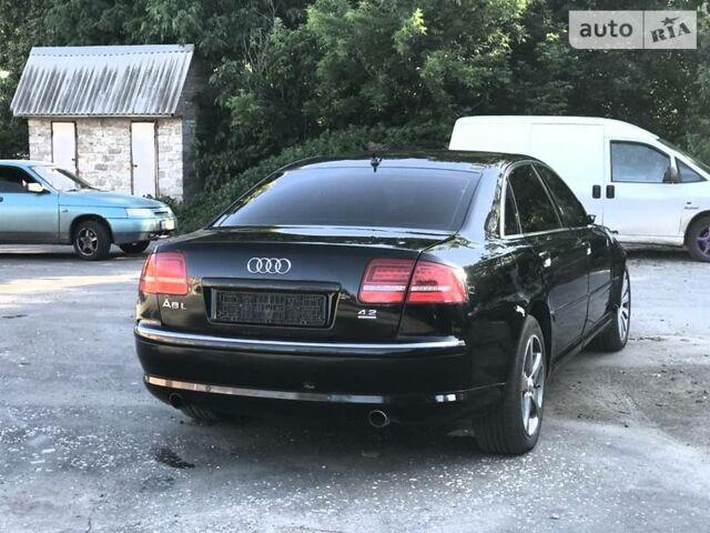 Черный Ауди А8, объемом двигателя 4.2 л и пробегом 165 тыс. км за 9200 $, фото 1 на Automoto.ua