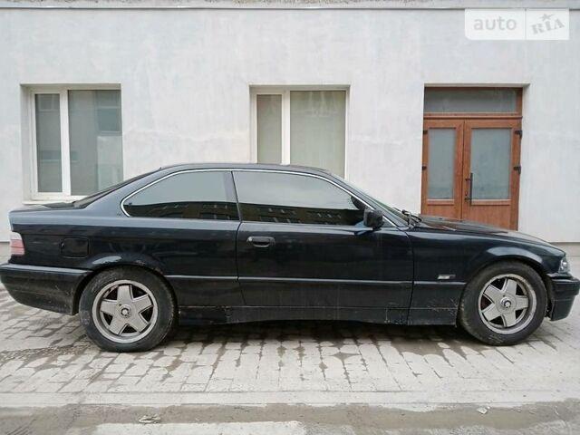 Черный БМВ 318, объемом двигателя 1.8 л и пробегом 300 тыс. км за 3450 $, фото 1 на Automoto.ua