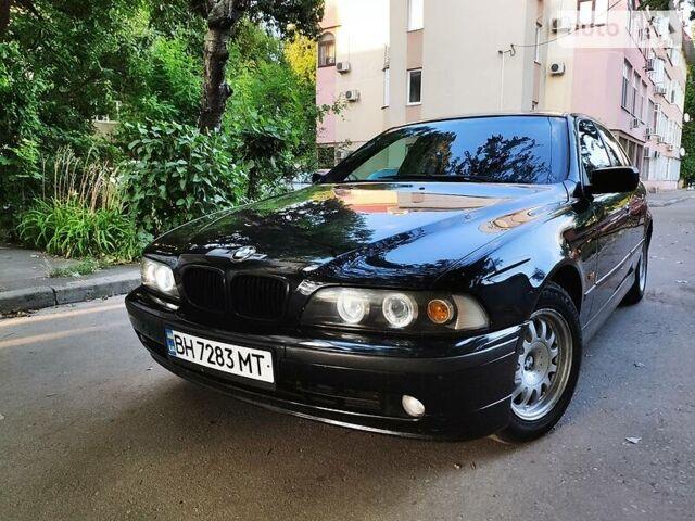 Черный БМВ 520, объемом двигателя 2 л и пробегом 259 тыс. км за 5900 $, фото 1 на Automoto.ua