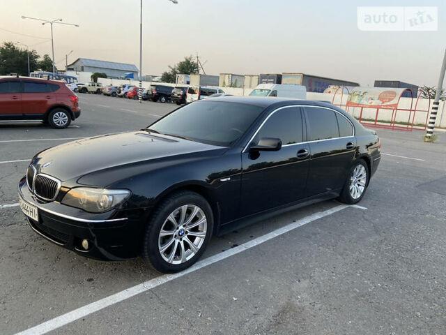 Черный БМВ 730, объемом двигателя 3 л и пробегом 241 тыс. км за 12100 $, фото 1 на Automoto.ua