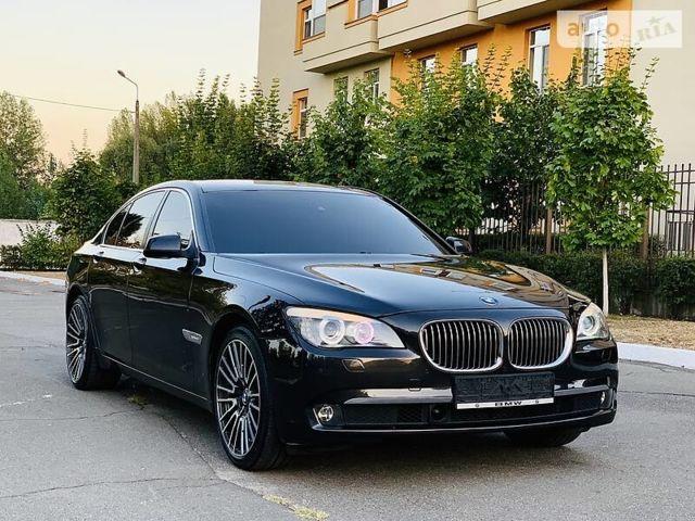 Черный БМВ 730, объемом двигателя 3 л и пробегом 129 тыс. км за 21200 $, фото 1 на Automoto.ua