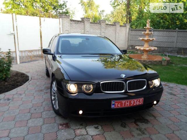 Черный БМВ 740, объемом двигателя 4 л и пробегом 185 тыс. км за 9700 $, фото 1 на Automoto.ua