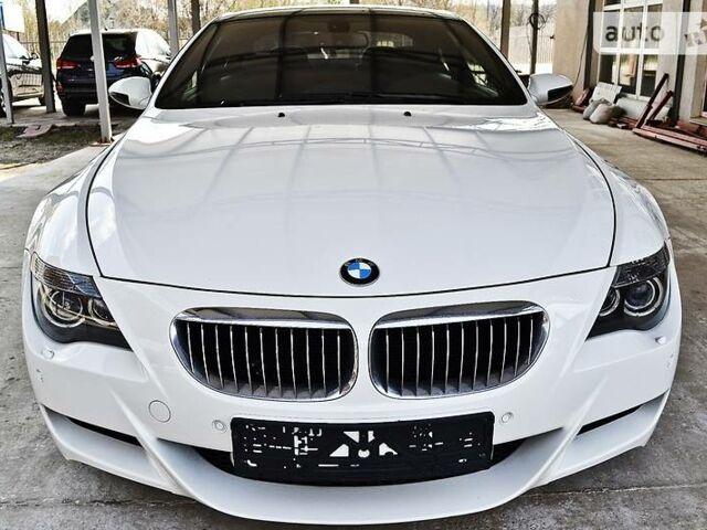 Белый БМВ М6, объемом двигателя 5 л и пробегом 70 тыс. км за 37600 $, фото 1 на Automoto.ua
