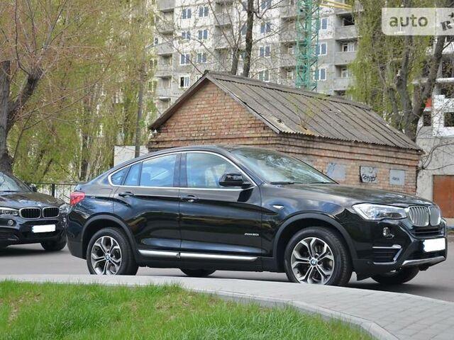 Черный БМВ Х4, объемом двигателя 2 л и пробегом 40 тыс. км за 45000 $, фото 1 на Automoto.ua