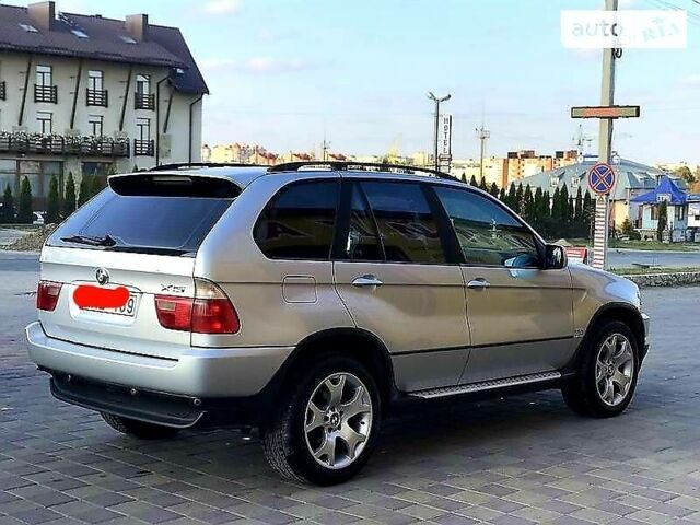 Серый БМВ Х5, объемом двигателя 3 л и пробегом 400 тыс. км за 12700 $, фото 1 на Automoto.ua