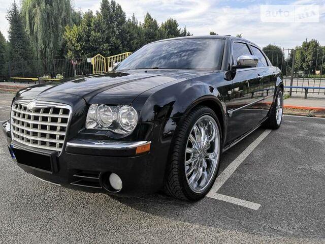 Черный Крайслер 300, объемом двигателя 5.7 л и пробегом 226 тыс. км за 10900 $, фото 1 на Automoto.ua