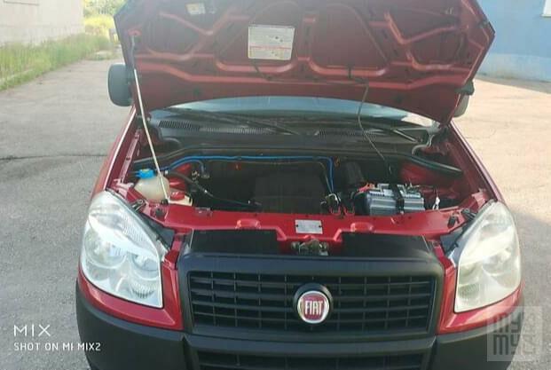 Красный Фиат Добло груз., объемом двигателя 1.4 л и пробегом 140 тыс. км за 5850 $, фото 1 на Automoto.ua
