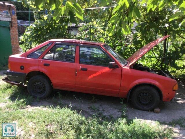 Красный Форд Эскорт, объемом двигателя 1.6 л и пробегом 177 тыс. км за 377 $, фото 1 на Automoto.ua