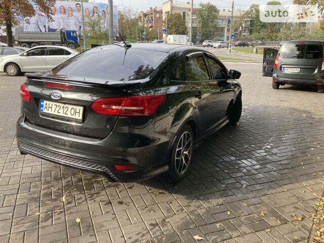 Черный Форд Фокус, объемом двигателя 2 л и пробегом 135 тыс. км за 8999 $, фото 1 на Automoto.ua