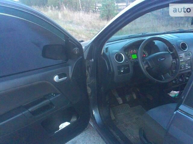 Серый Форд Фьюжн, объемом двигателя 1.4 л и пробегом 154 тыс. км за 5950 $, фото 1 на Automoto.ua
