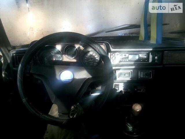 Черный ГАЗ 24, объемом двигателя 2.4 л и пробегом 200 тыс. км за 1000 $, фото 1 на Automoto.ua