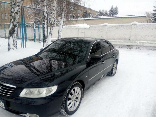 Черный Хендай Грандер, объемом двигателя 3.3 л и пробегом 246 тыс. км за 8100 $, фото 1 на Automoto.ua