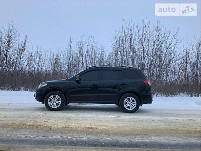 Черный Хендай Санта Фе, объемом двигателя 2.2 л и пробегом 124 тыс. км за 15500 $, фото 1 на Automoto.ua