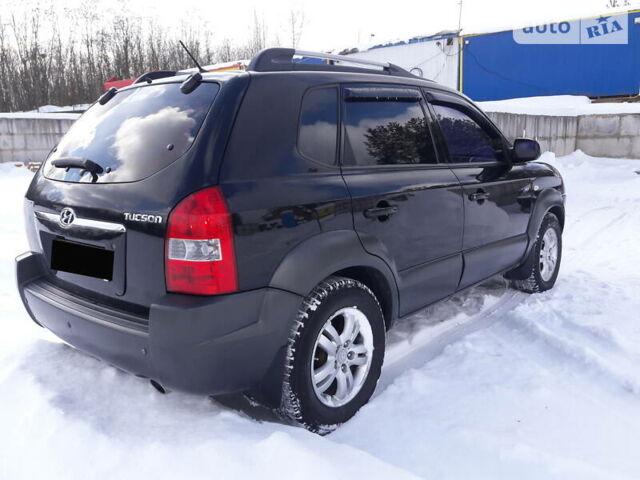 Черный Хендай Туксон, объемом двигателя 2 л и пробегом 220 тыс. км за 8900 $, фото 1 на Automoto.ua