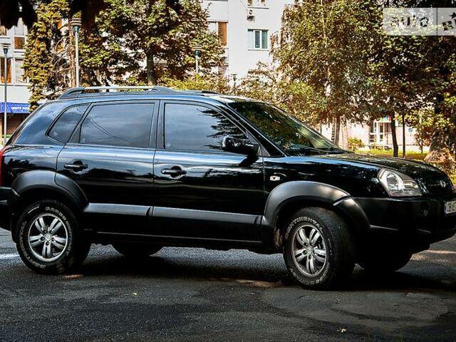 Черный Хендай Туксон, объемом двигателя 2 л и пробегом 163 тыс. км за 11200 $, фото 1 на Automoto.ua