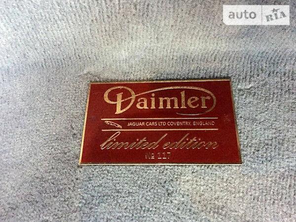 Гранатовый Ягуар Даймлер, объемом двигателя 4.2 л и пробегом 112 тыс. км за 42000 $, фото 1 на Automoto.ua