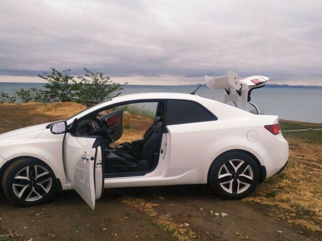 Білий Кіа Черато, об'ємом двигуна 2 л та пробігом 122 тис. км за 9000 $, фото 1 на Automoto.ua