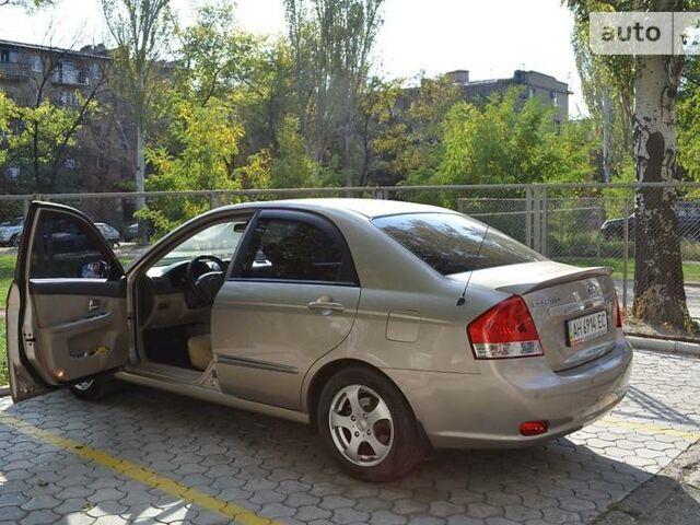 Бронзовый Киа Черато, объемом двигателя 2 л и пробегом 133 тыс. км за 6600 $, фото 1 на Automoto.ua