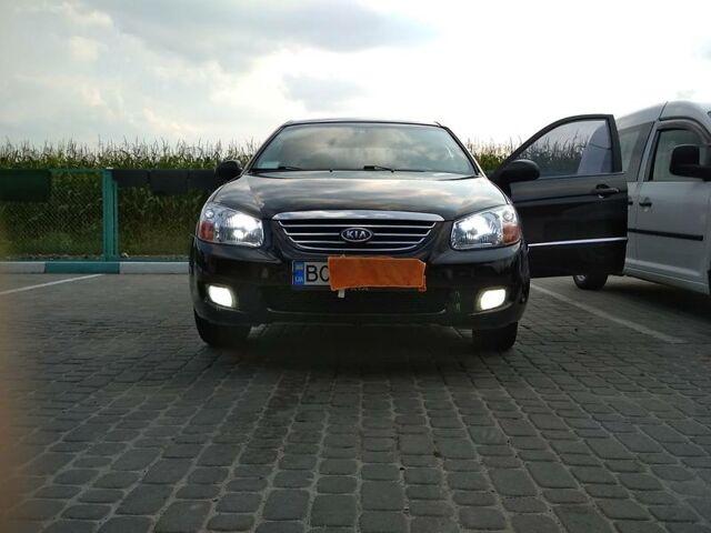 Черный Киа Черато, объемом двигателя 1.6 л и пробегом 146 тыс. км за 7000 $, фото 1 на Automoto.ua