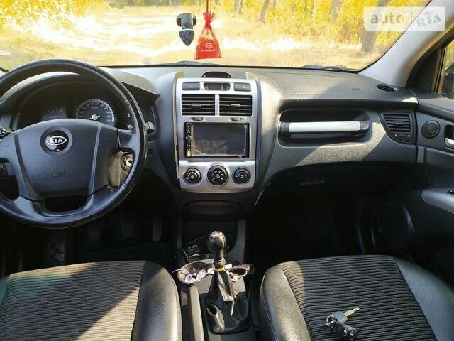 Черный Киа Sportage, объемом двигателя 2 л и пробегом 203 тыс. км за 8200 $, фото 1 на Automoto.ua