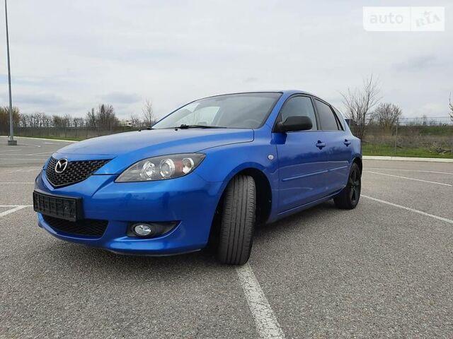 Синий Мазда 3, объемом двигателя 1.6 л и пробегом 210 тыс. км за 5999 $, фото 1 на Automoto.ua