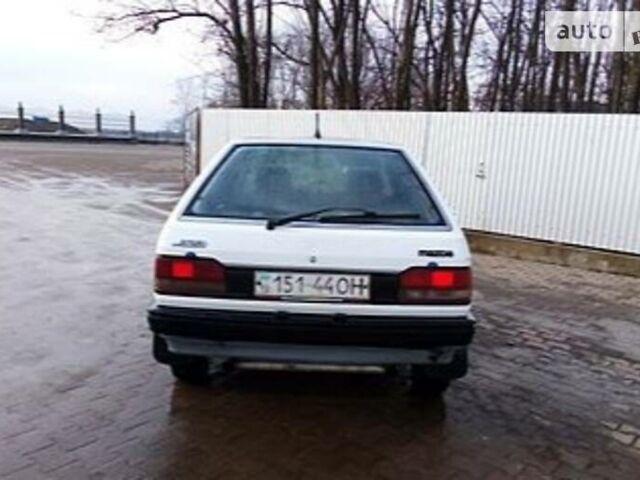Белый Мазда 323, объемом двигателя 0 л и пробегом 400 тыс. км за 1100 $, фото 1 на Automoto.ua