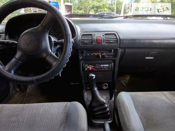 Червоний Мазда 323, об'ємом двигуна 1.8 л та пробігом 370 тис. км за 2000 $, фото 1 на Automoto.ua
