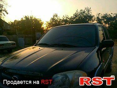 Черный Мазда Трибьют, объемом двигателя 3 л и пробегом 1 тыс. км за 4000 $, фото 1 на Automoto.ua