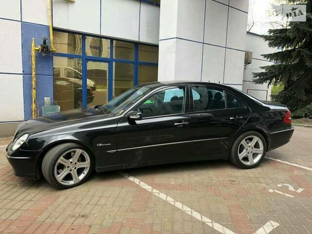 Чорний Мерседес Е 400, об'ємом двигуна 4 л та пробігом 190 тис. км за 6427 $, фото 1 на Automoto.ua