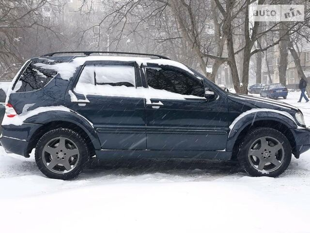 Чорний Мерседес МЛ 55 АМГ, об'ємом двигуна 5.4 л та пробігом 263 тис. км за 12500 $, фото 1 на Automoto.ua
