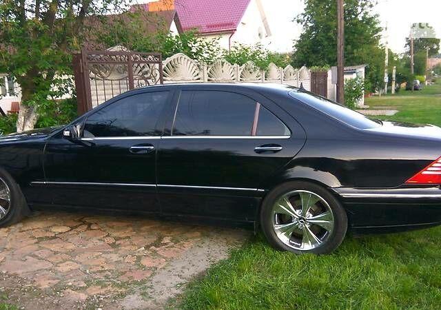 Черный Мерседес С 500, объемом двигателя 5 л и пробегом 305 тыс. км за 8500 $, фото 1 на Automoto.ua