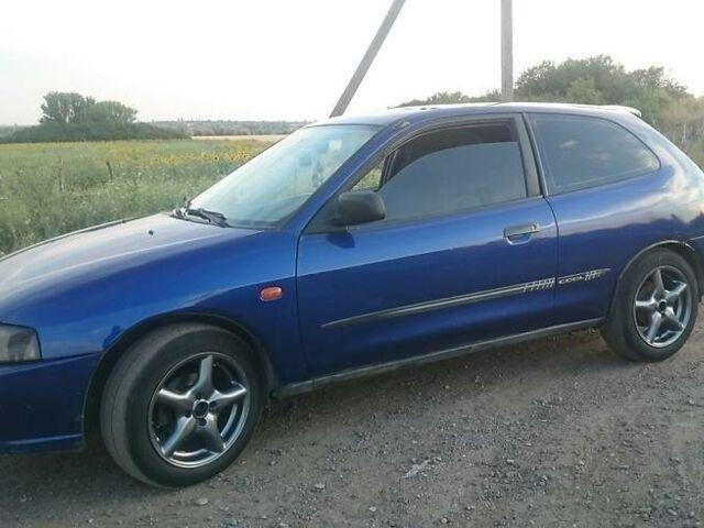 Синій Міцубісі Кольт, об'ємом двигуна 1.3 л та пробігом 335 тис. км за 3000 $, фото 1 на Automoto.ua