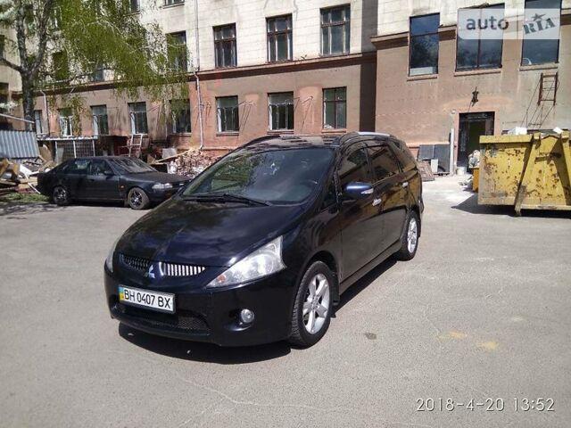Чорний Міцубісі Грандіс, об'ємом двигуна 2.4 л та пробігом 258 тис. км за 7800 $, фото 1 на Automoto.ua
