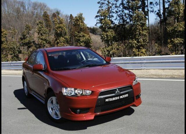 Красный Мицубиси Лансер, объемом двигателя 2 л и пробегом 147 тыс. км за 6100 $, фото 1 на Automoto.ua
