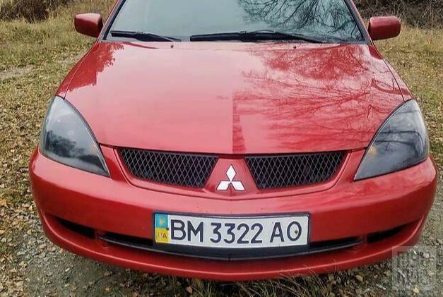 Красный Мицубиси Лансер, объемом двигателя 1.6 л и пробегом 236 тыс. км за 5500 $, фото 1 на Automoto.ua