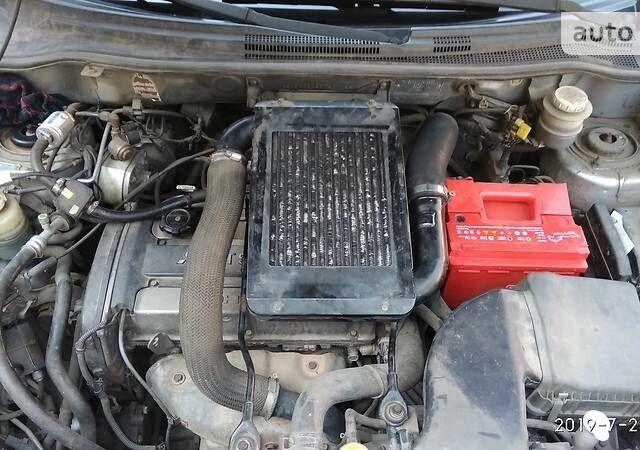 Серый Мицубиси Аутлендер, объемом двигателя 2 л и пробегом 192 тыс. км за 7499 $, фото 1 на Automoto.ua