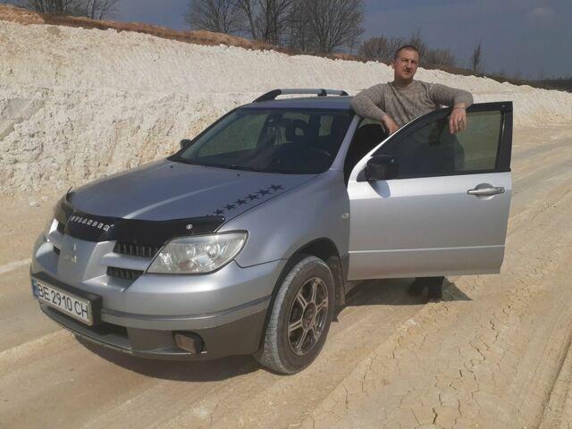 Серый Мицубиси Аутлендер, объемом двигателя 2 л и пробегом 625 тыс. км за 6000 $, фото 1 на Automoto.ua